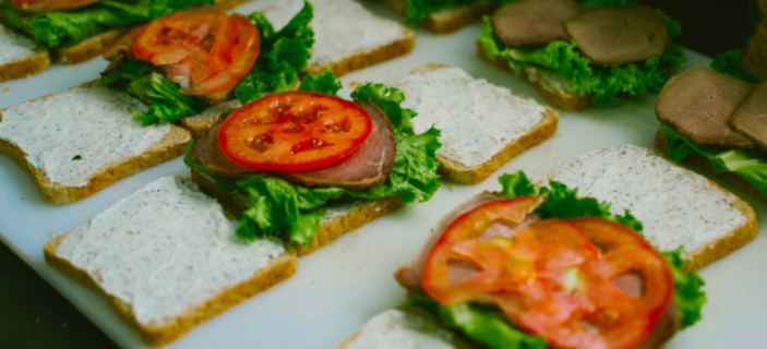 A photo (by Fábio Alves on Unsplash) of several open sandwiches