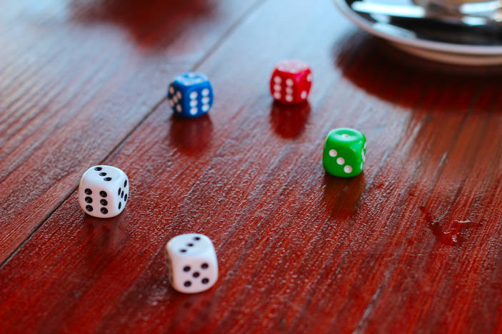 A photo of dice (by Lea Böhm on Unsplash) of some gaming dice