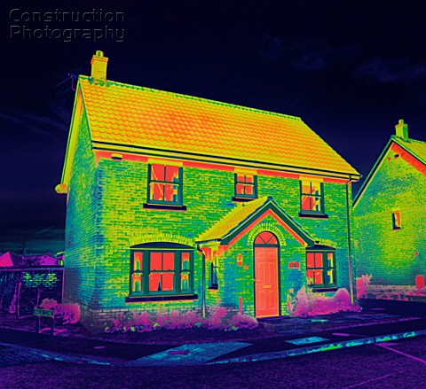 A thermal image of a house - shows where money can be saved