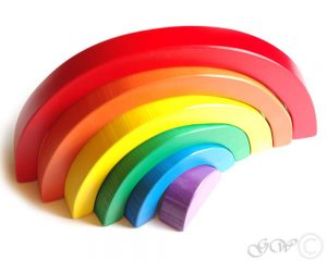 A gorgeous wooden rainbow stacking toy