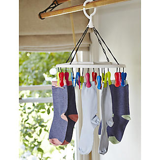 Socks pegged out to dry on a small clothes airer