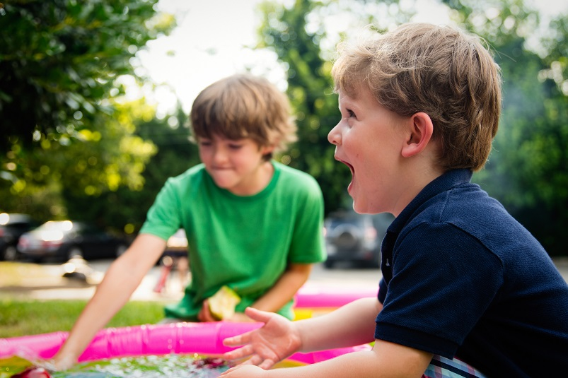 A photo by Ashton Bingham on Unsplash - of two boys playing party games