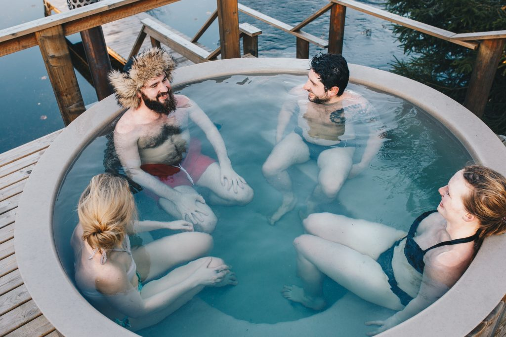 Four people soaking in a hot tub