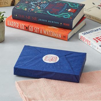 Gift subscription book wrapped in tissue paper