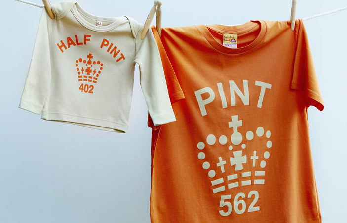"""A photo of matching t-shirts, one for a child saying """"half pint"""" the other for a parent saying """"Pint"""""""
