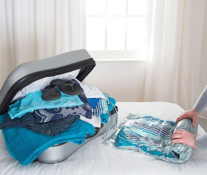 Packmate 3-Piece Suitcase Vacuum Storage Bag Set being used – with the bags rolled to remove the air
