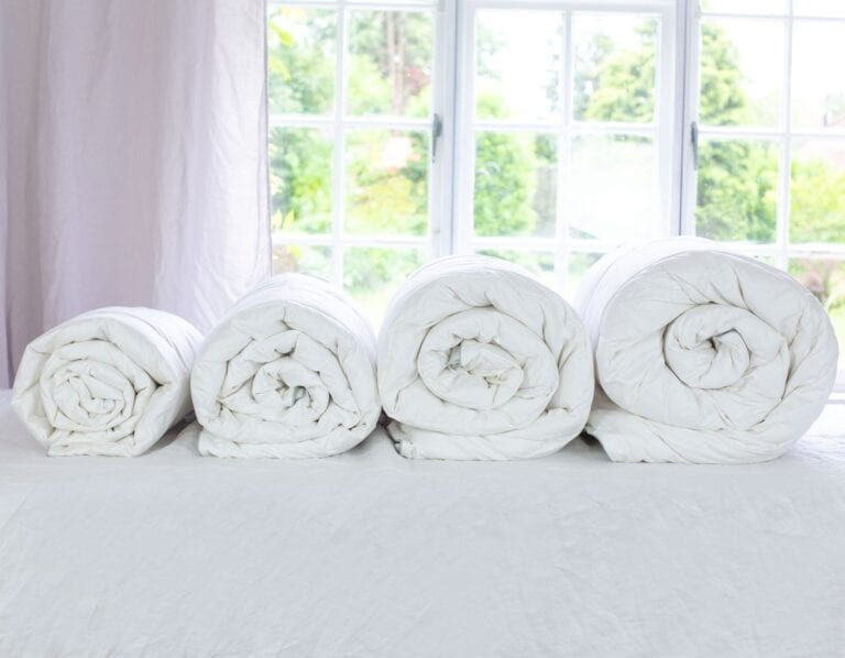 A photo of four duvets from Scooms - from single bed to super king size, all in Hungarian Goose Down