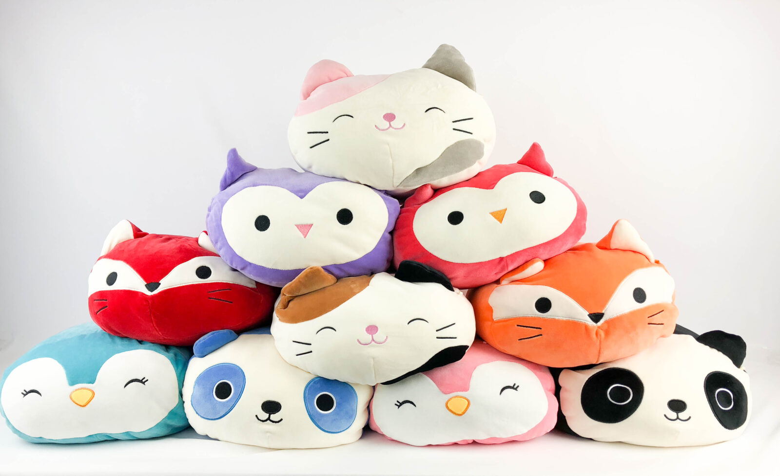 A picture of stackable Squishmallow cuddly toys
